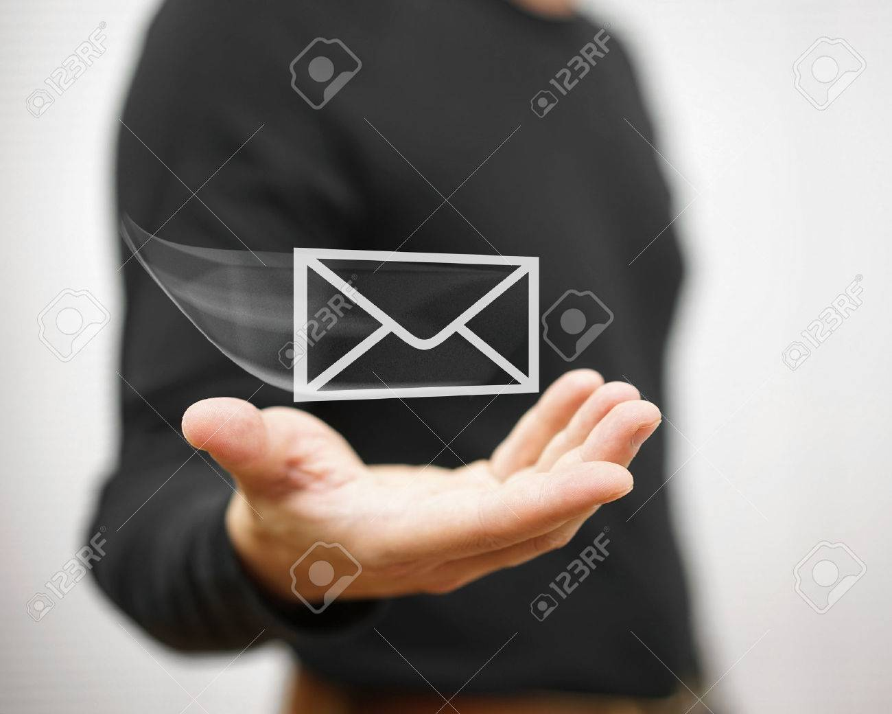 man holds a virtual postal envelope, concept of email, internet and networking Stock Photo - 47708007