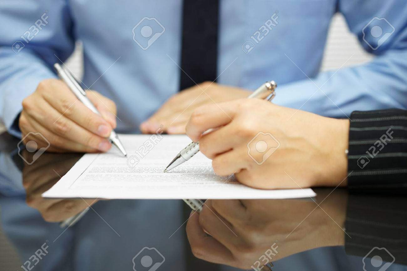business team in meeting is working together on financial or legal document Standard-Bild - 47708035