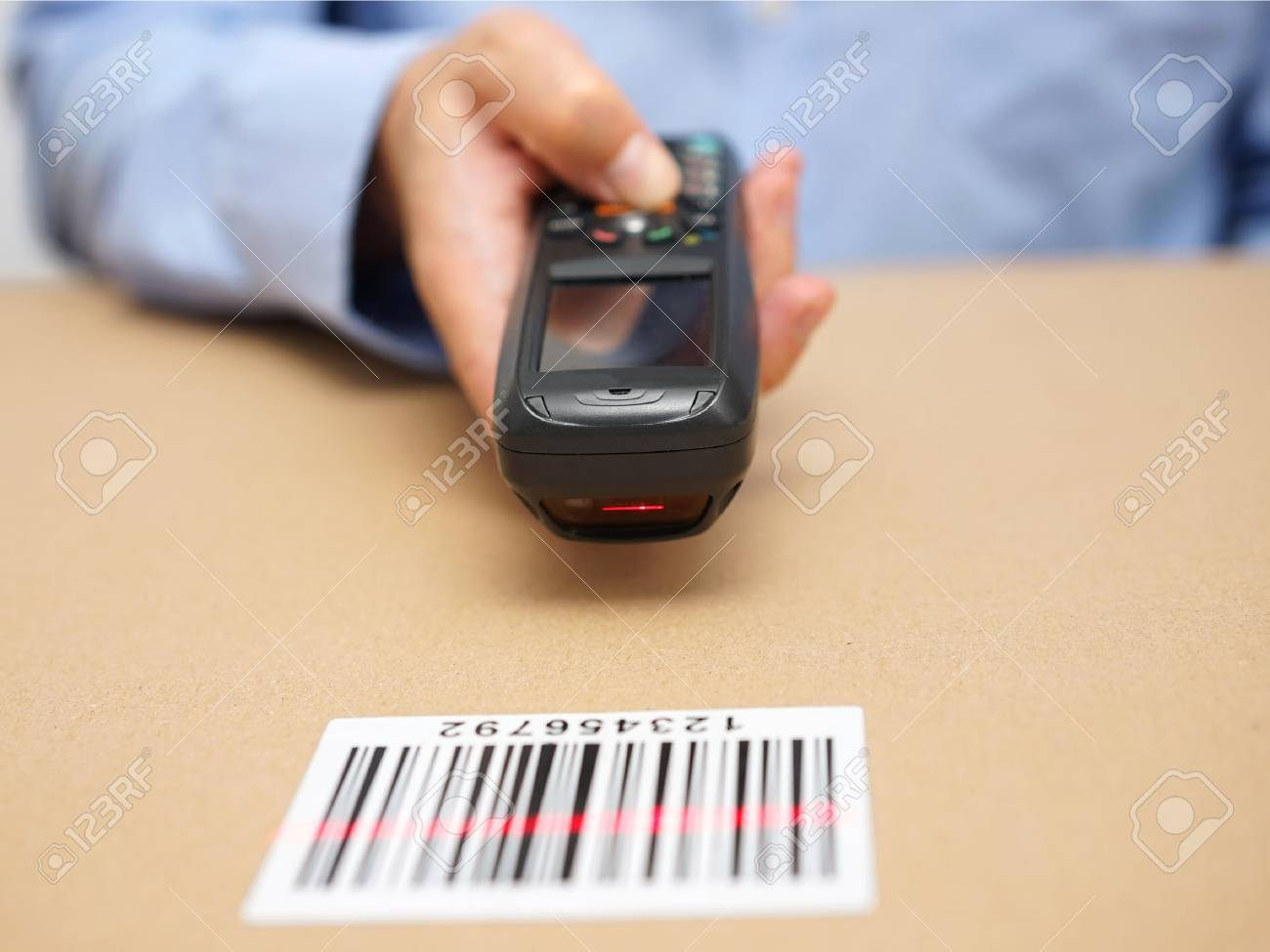 warehouse technician inspects stocks in storage with bar code reader Stock Photo - 47708023