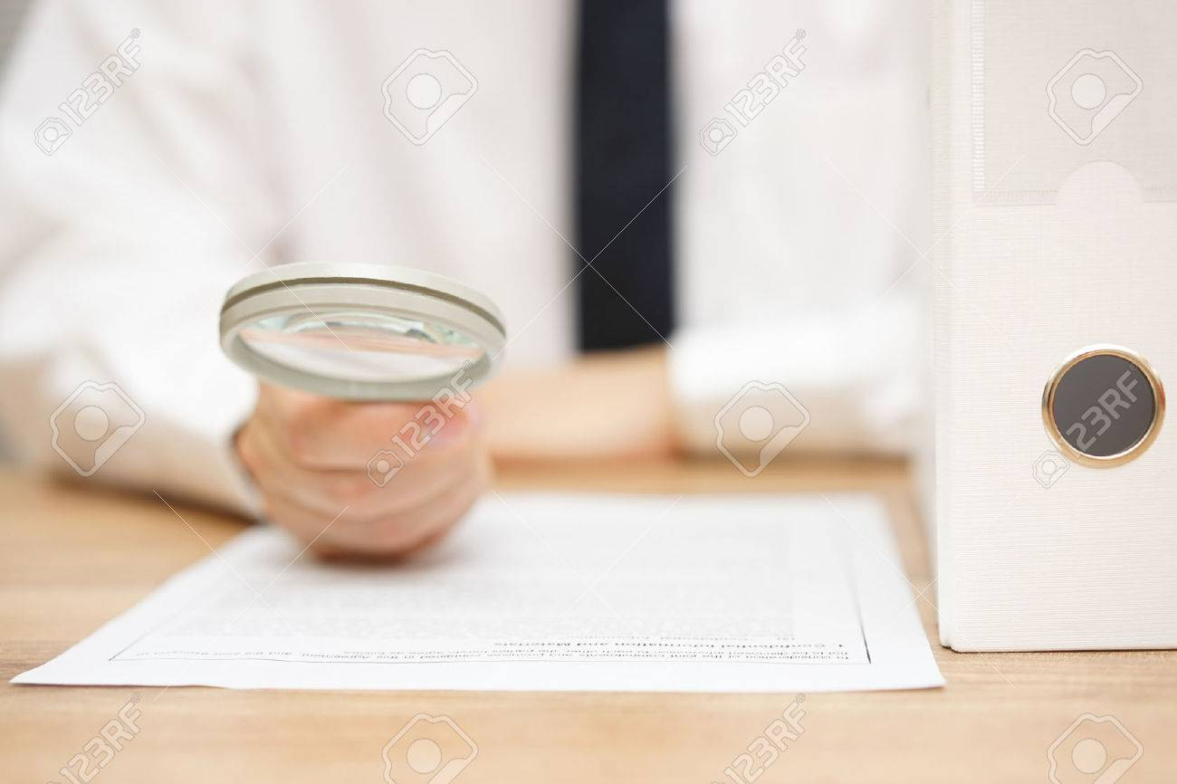 businessman is reviewing company documentation on workplace, due diligence concept Standard-Bild - 47708379