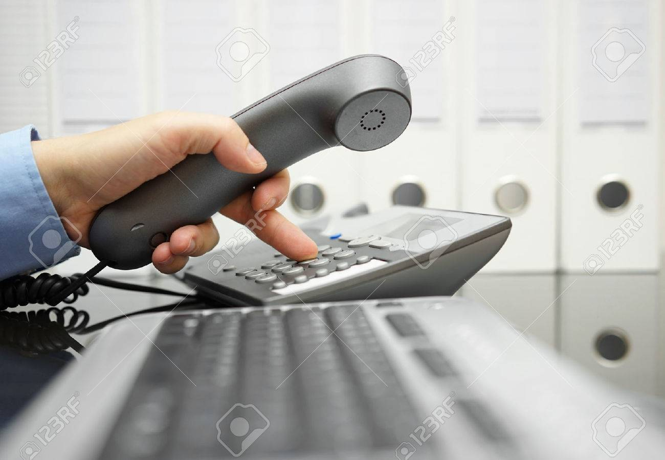 businessman  on the workplace is calling his  client Standard-Bild - 47709692