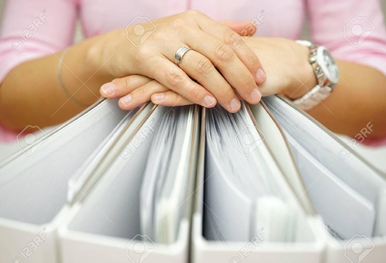 Secretary holding binders, concept of accounting,business,documentation,paperwork Stock Photo - 47720495
