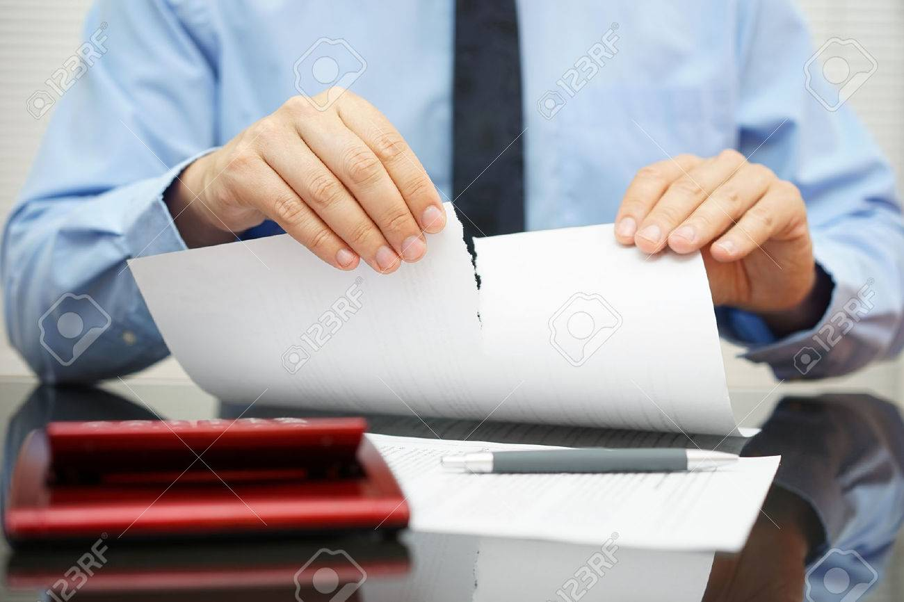 businessman tears document in office Stock Photo - 47721144