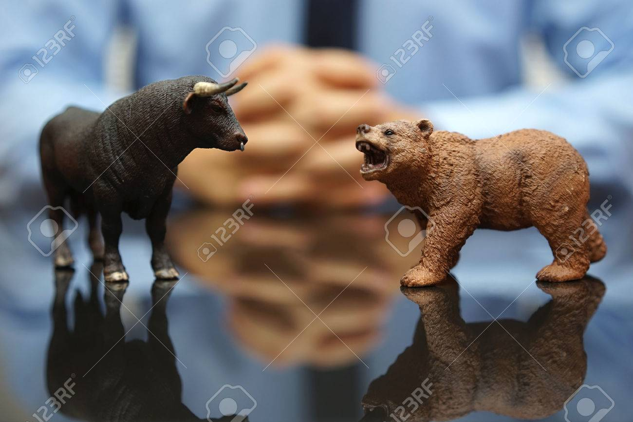 businessman is watching bull and bear , concept of stock market and investing Standard-Bild - 47721145