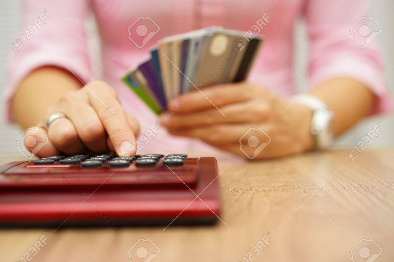 woman calculate how much cost or spending have with credit cards Standard-Bild - 47721182