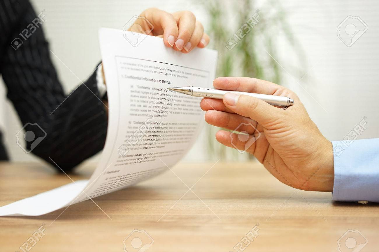 businesswoman holding legal document and  wants an explaination about article in contract Stock Photo - 51619024