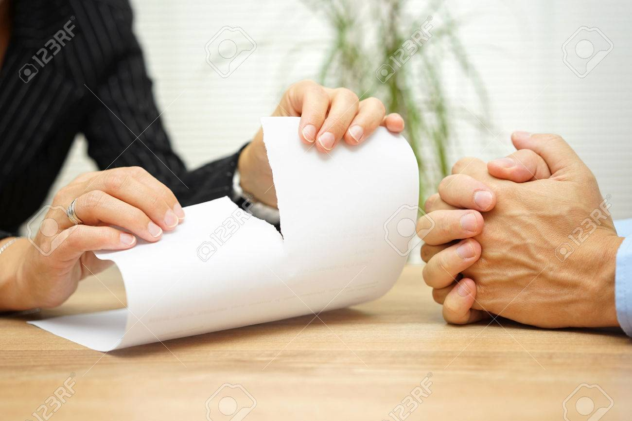 On meeting woman  tearing the document from his colleague or partner Standard-Bild - 51619037
