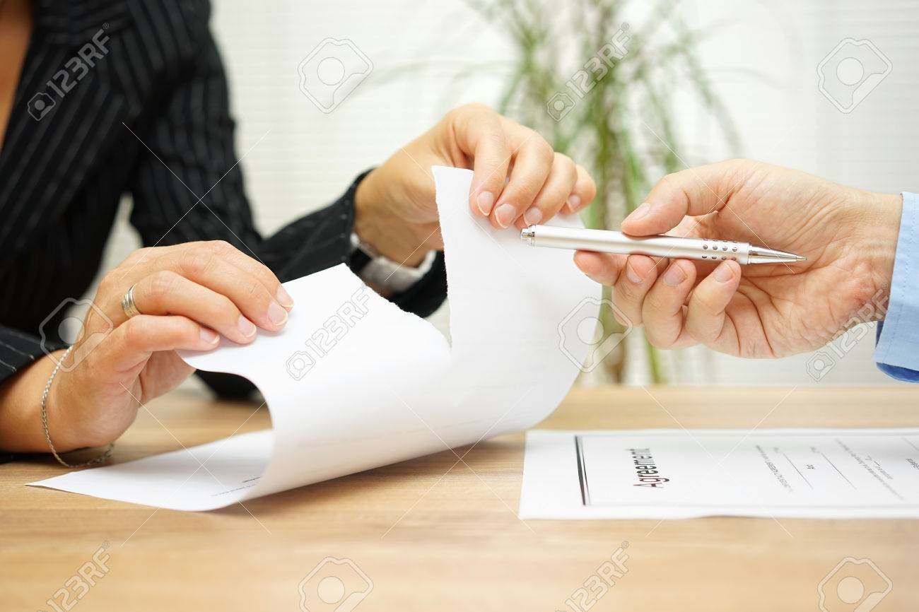 Woman tears agreement documents in front of agent who wants to get a signature - 51619076