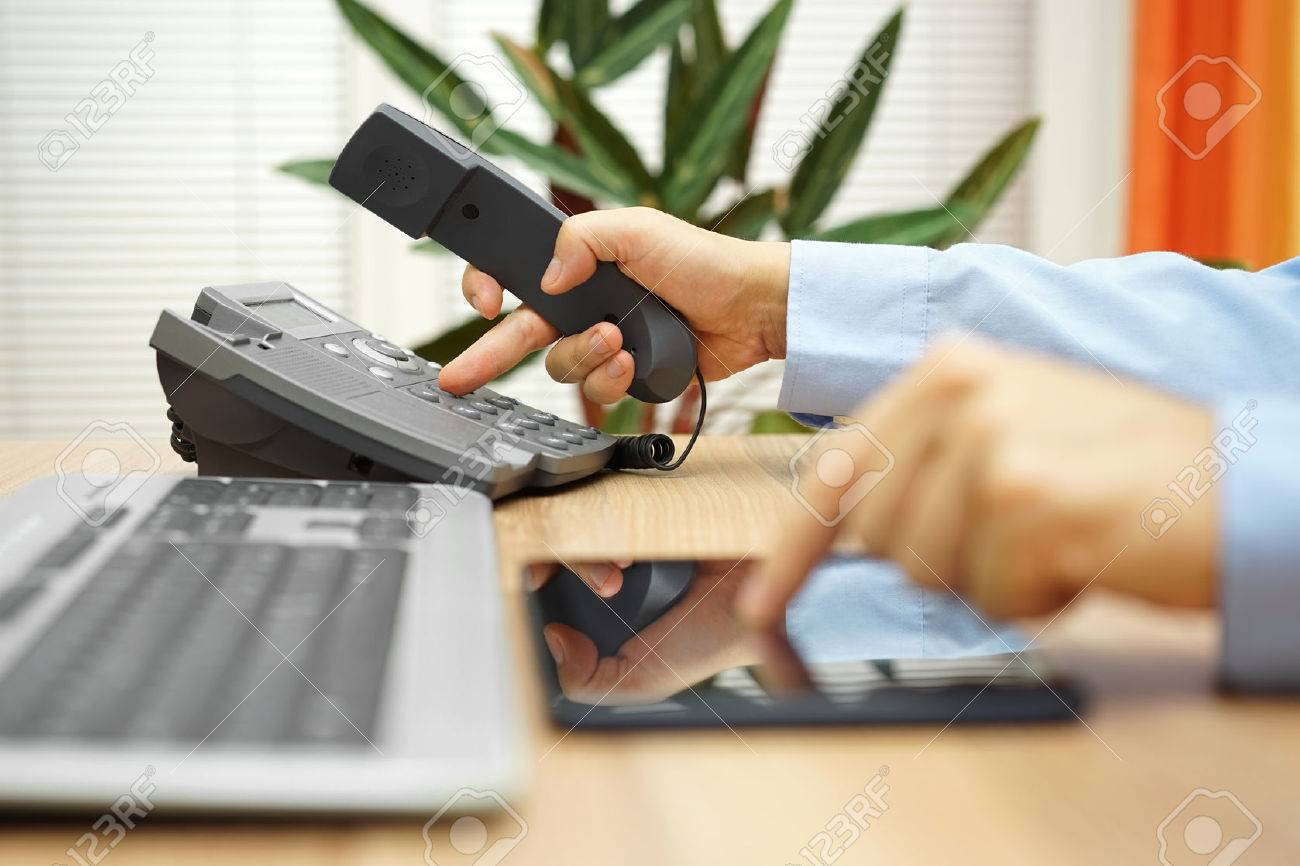 businessman working on tablet computer  is calling service for support Stock Photo - 54519570