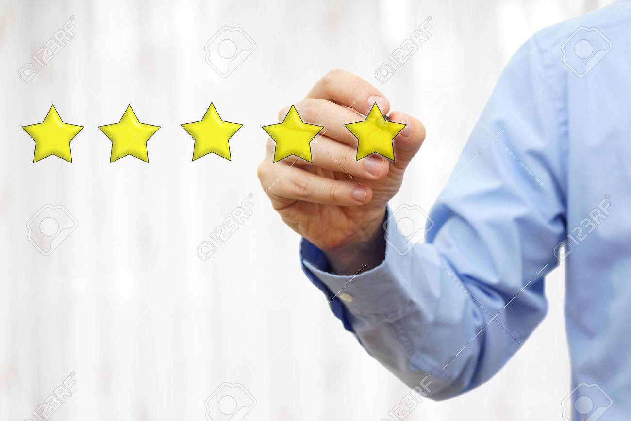 businessman drawing five star rating,concept of quality and luxury Stock Photo - 54519930