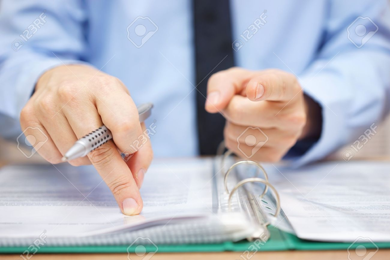 Tax inspector is pointing to you, tax evasion concept Stock Photo - 56353063