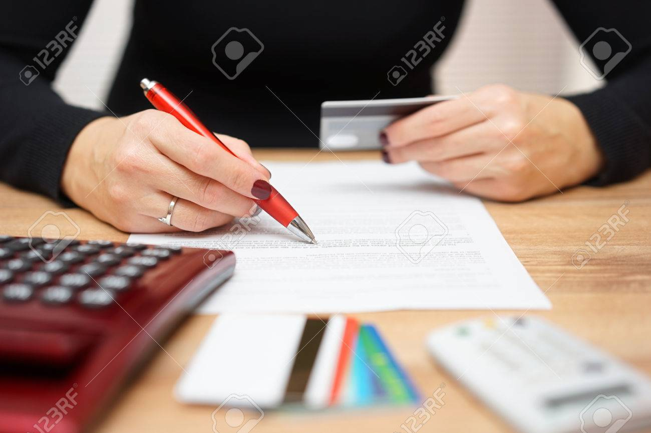 woman is opening bank account and checking  credit card informations Stock Photo - 56812638