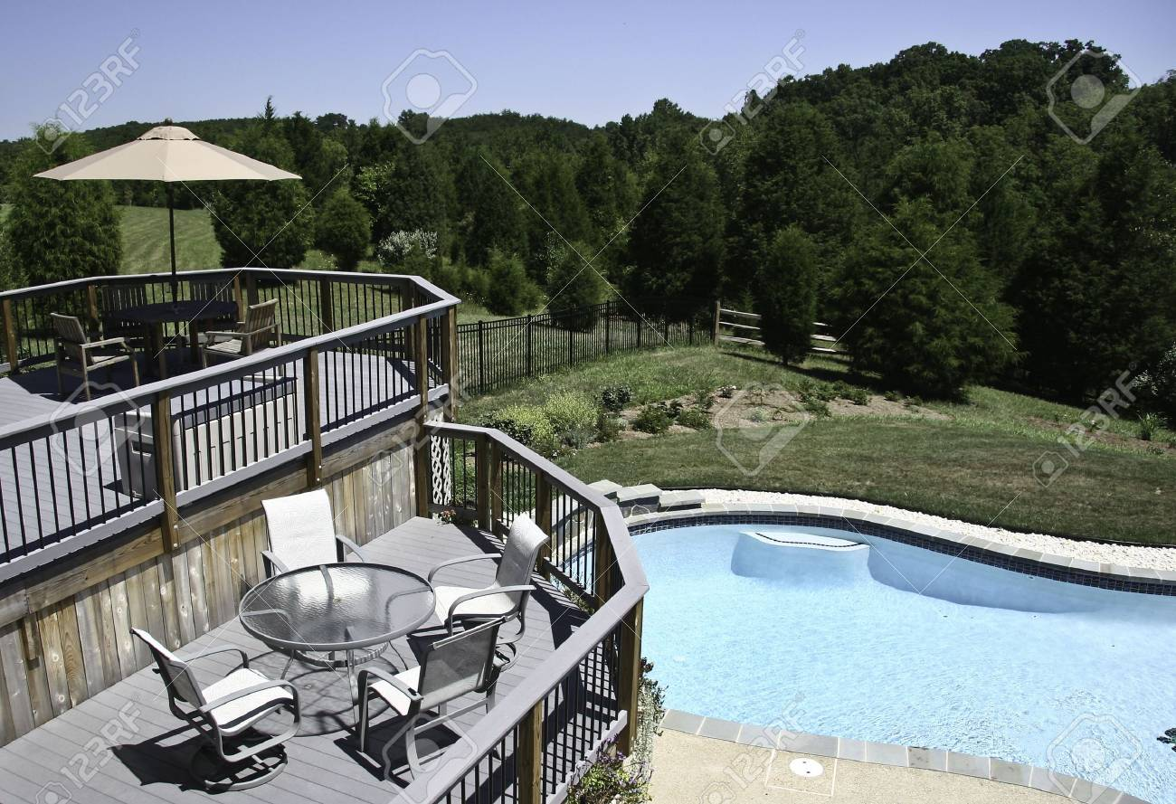 Backyard Pool in summer with surrounding multi-level deck Stock Photo - 2923096