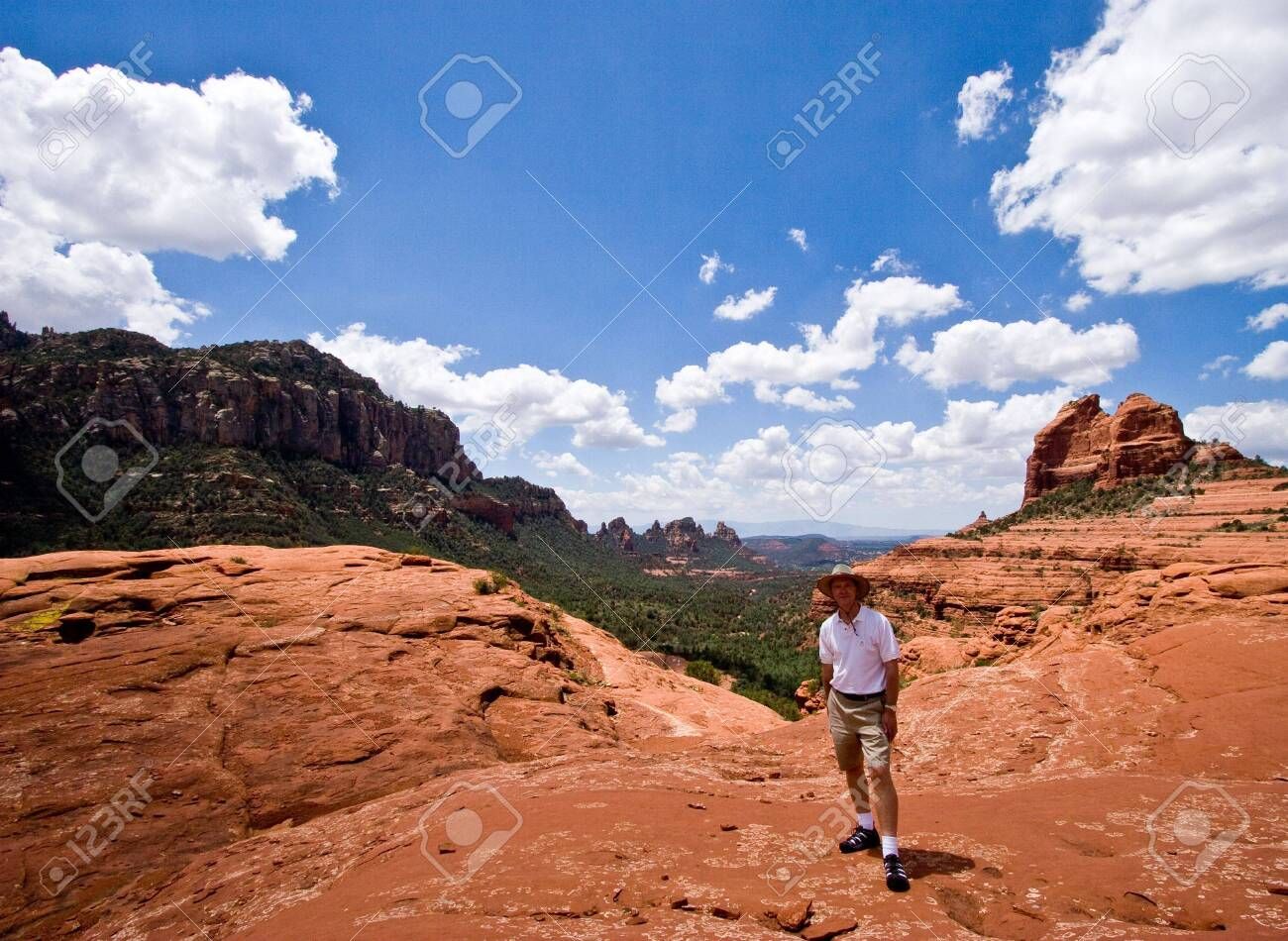 Single hiker in red rock area of Sedona facing the camera Stock Photo - 2923100