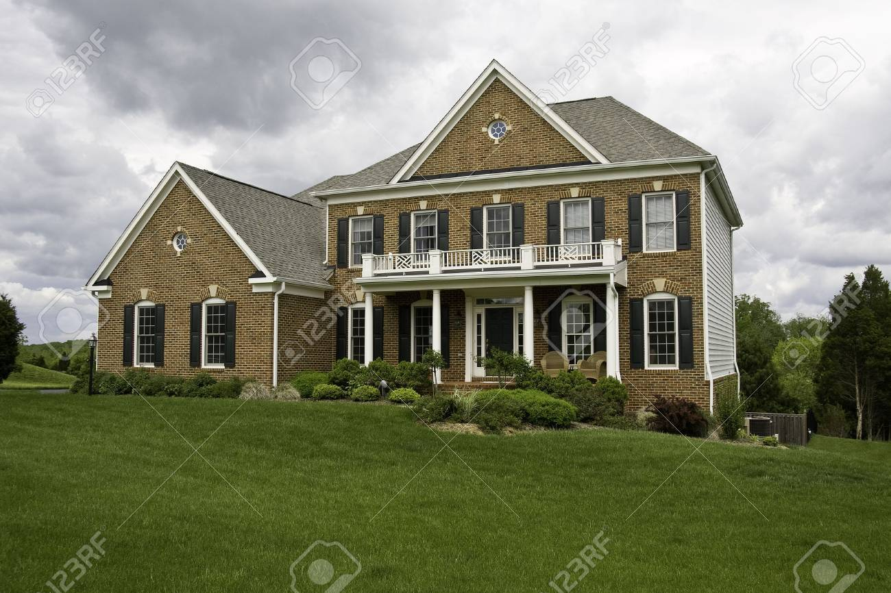 Modern House with landscaped lawn and garden on a bright but cloudy day Stock Photo - 3042600