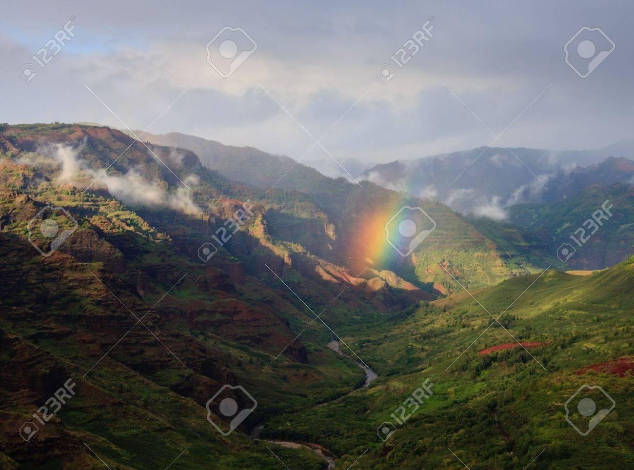 Rainbow in the center of the river valley of Waimea Canyon on Kauai Stock Photo - 4288386