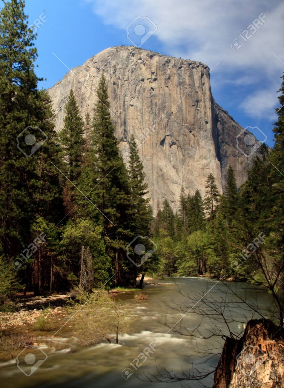 Yosemite view with slow shutter speed providing smoothed calm waters of rushing river Stock Photo - 4924217