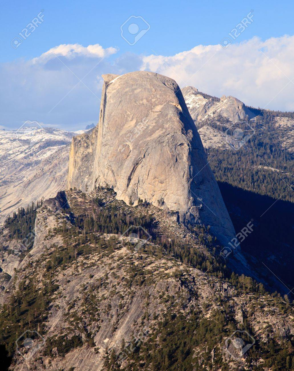 Snow covered Sierra mountains behind Half Dome at sunset Stock Photo - 5300257