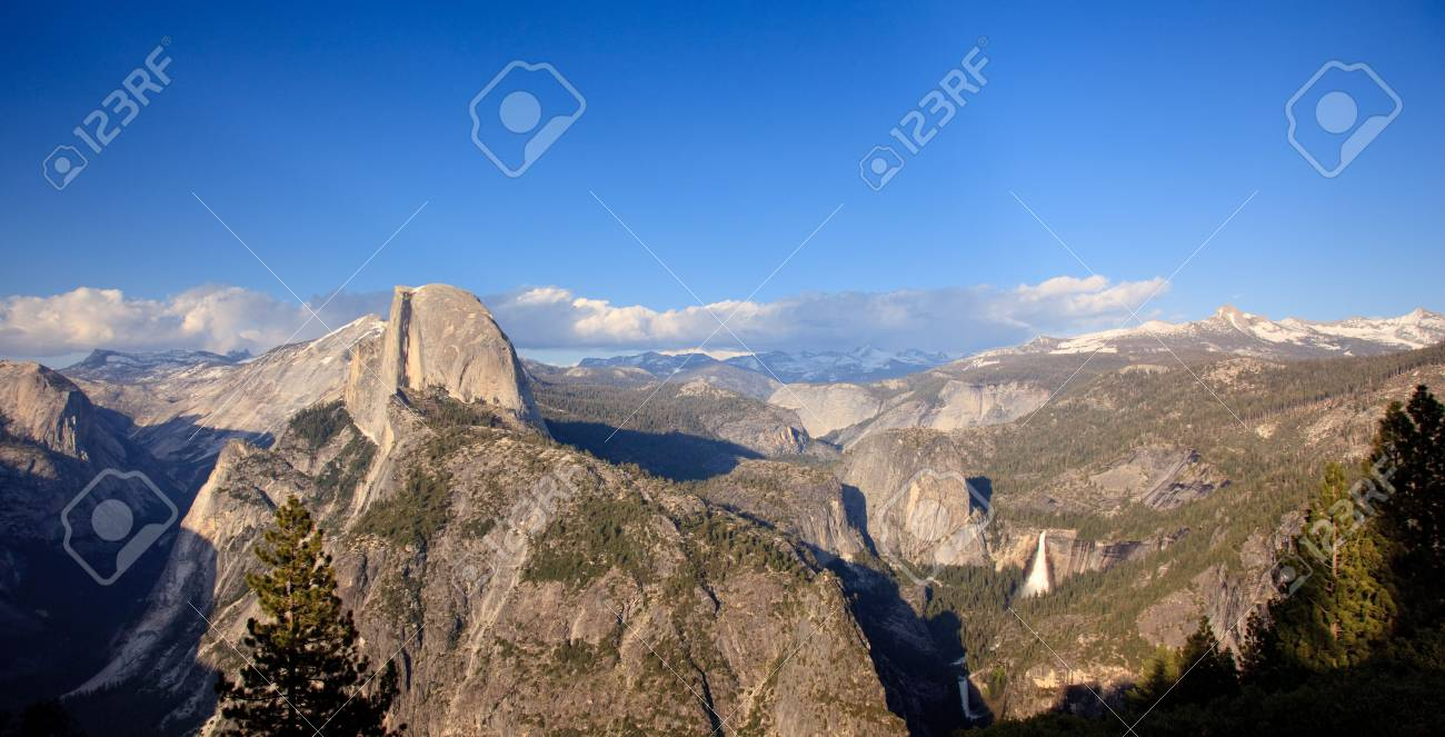 Panorama format of Yosemite Valley with Half Dome at sunset Stock Photo - 5300254