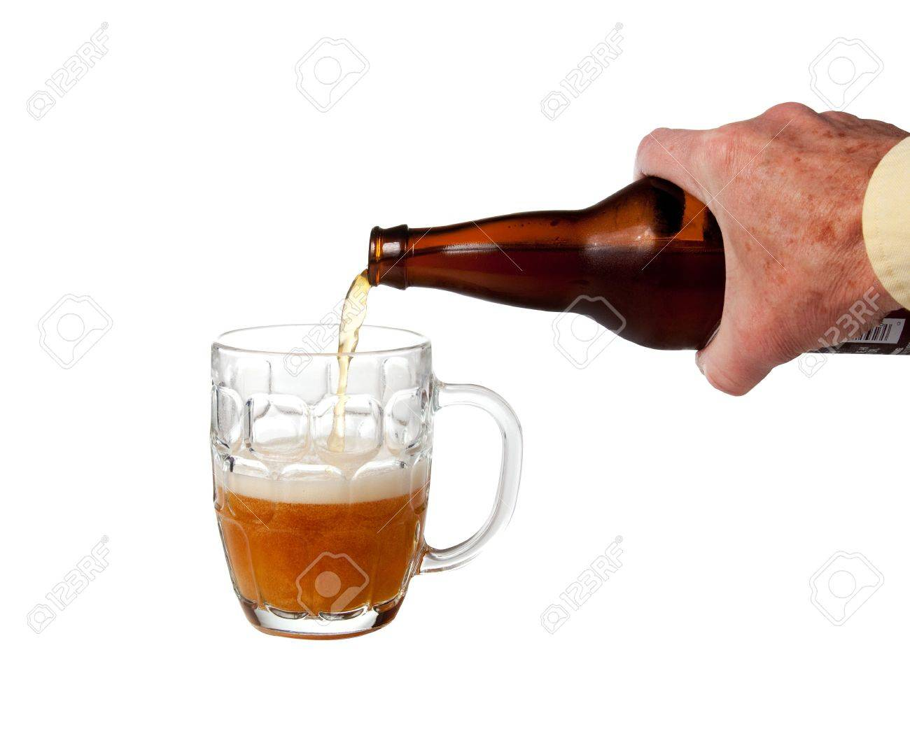 Golden ale being poured from brown bottle into half full english pint mug Stock Photo - 5936583