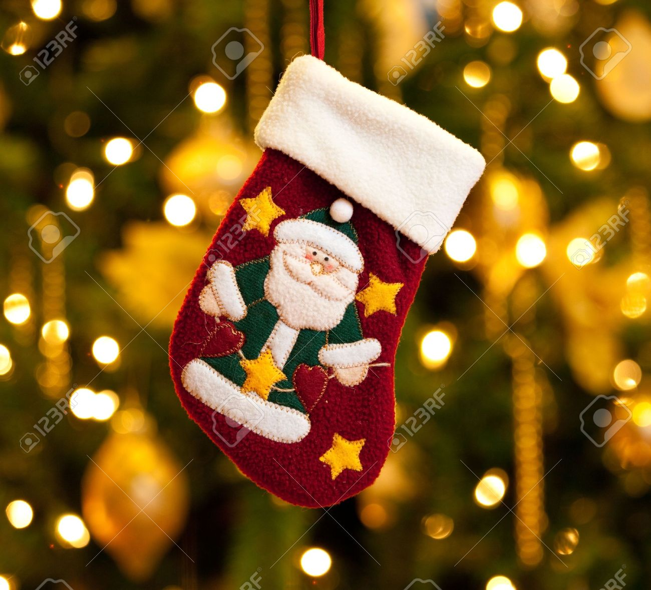 Close Up Of Child's Christmas Stocking In Front Of Out Of Focus ...