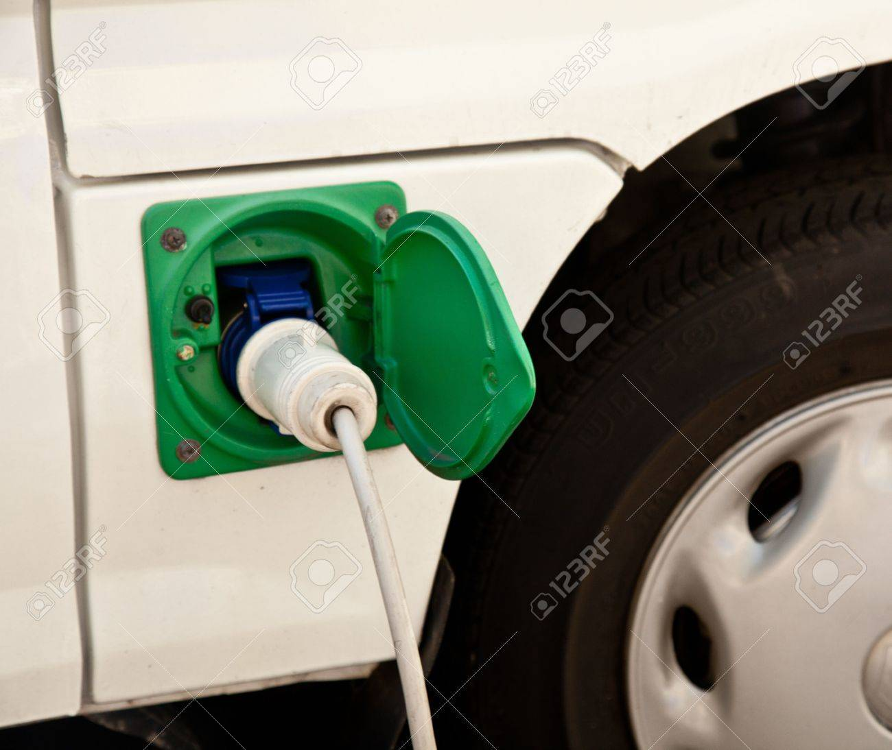Electricity powered vehicle being recharged from the main electric supply Stock Photo - 7614384