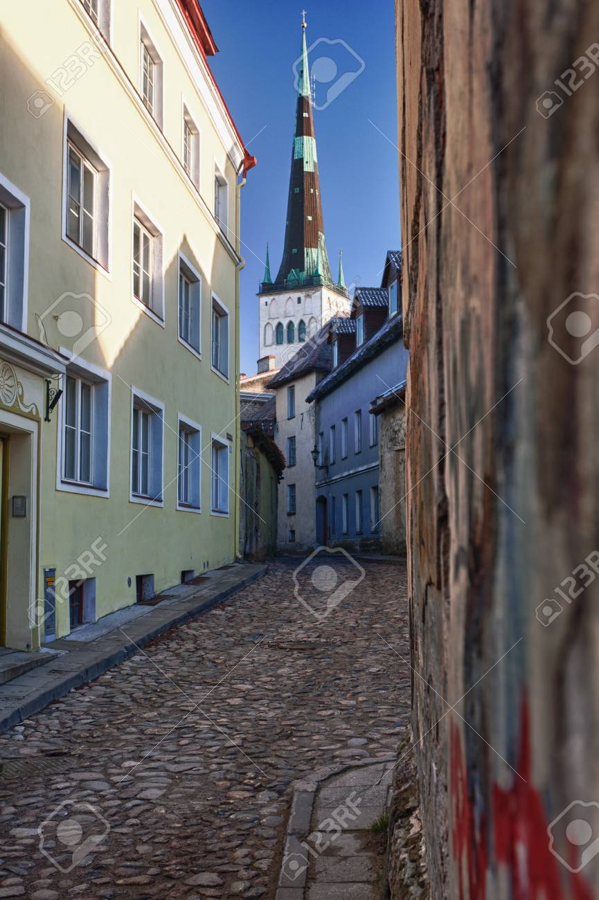Old street in Tallinn Estonia showing cobbled road and the old church Stock Photo - 8287349