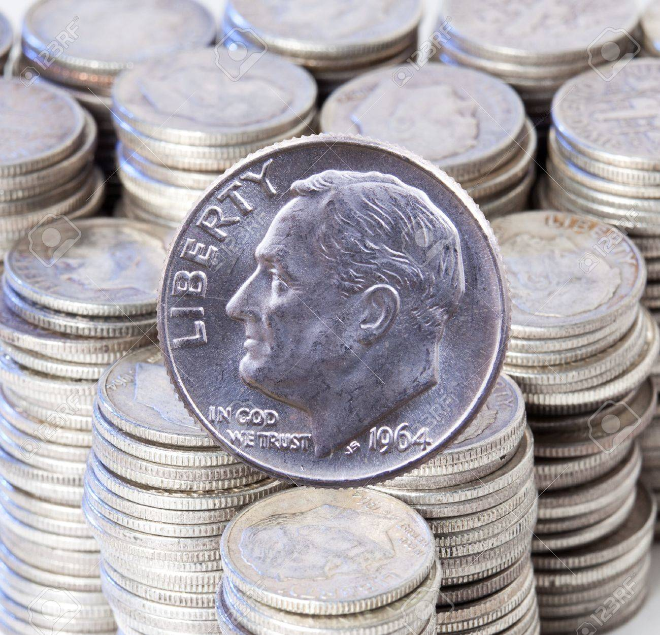 Pre 1964 dimes were 90% pure silver and are collectible. A good example of a Roosevelt dime against a stacks of similar silver dimes Stock Photo - 9227138