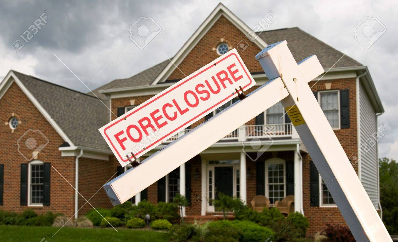 Leaning foreclosure sign in front of a modern single family home on a cloudy cold day Stock Photo - 9227137