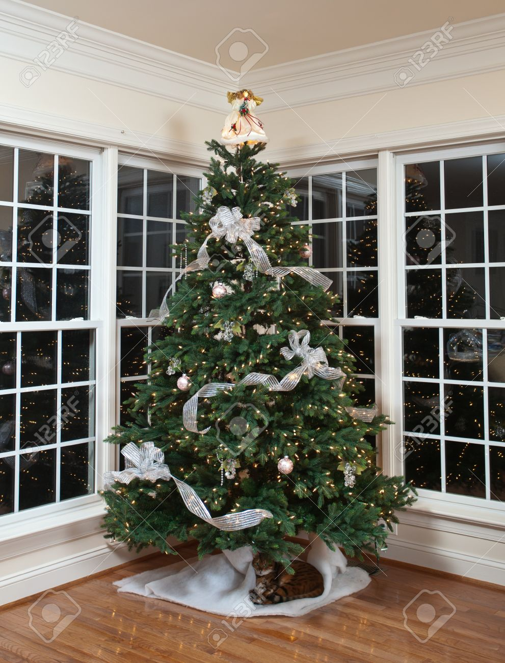 Christmas Tree Decorated With Silver And White Ribbons And Ornaments Stock Photo Picture And Royalty Free Image Image 11526593