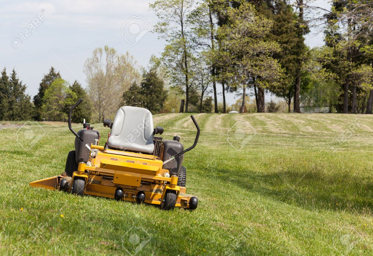 No Person On Expansive Lawn With A Yellow Zero Turn Mower Stock