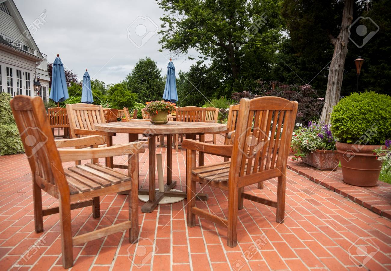Many wooden teak tables and chairs on brick pation in cafe or restaurant Stock Photo - 13865377