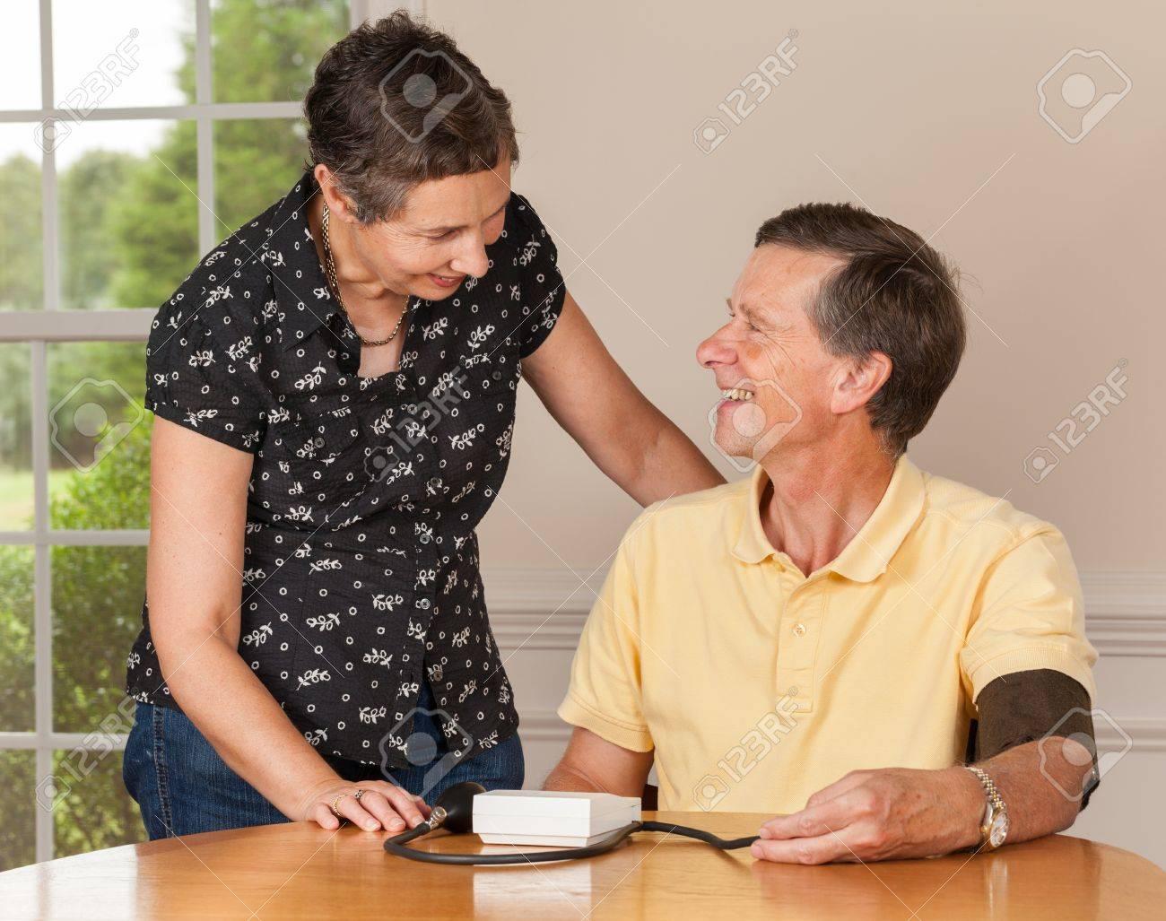 Senior caucasian retired male taking blood pressure at home Stock Photo - 14443221