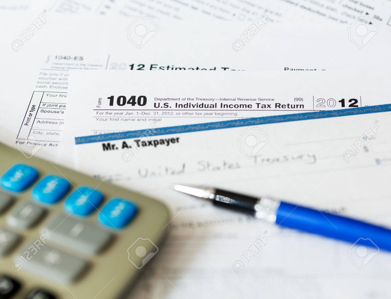 Tax form 1040 for tax year 2012 for us individual tax return stock tax form 1040 for tax year 2012 for us individual tax return with pen and check falaconquin