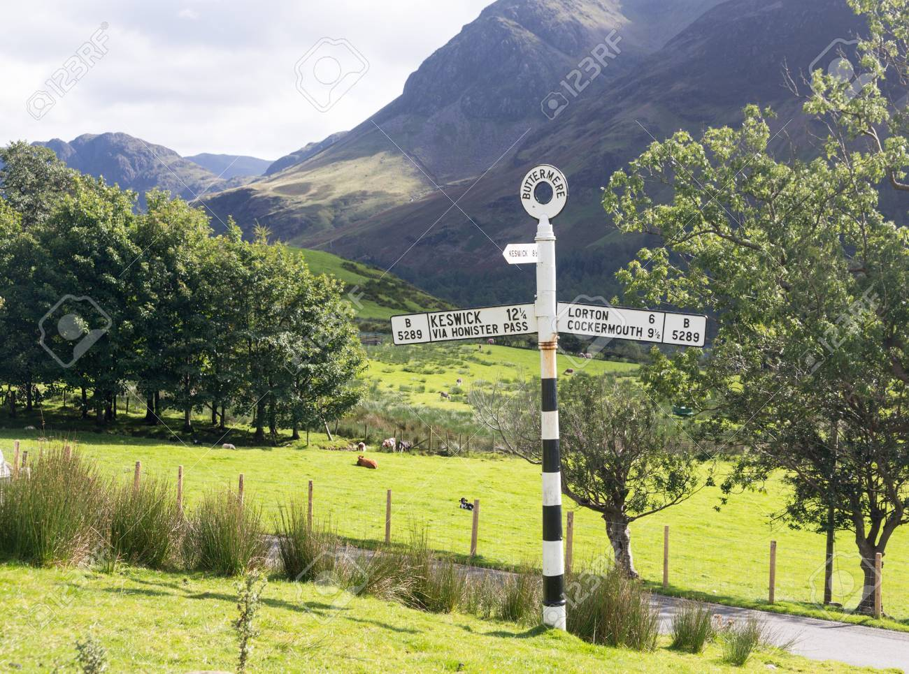 Old signpost near Wrynose Pass in Lake District Stock Photo - 15363366