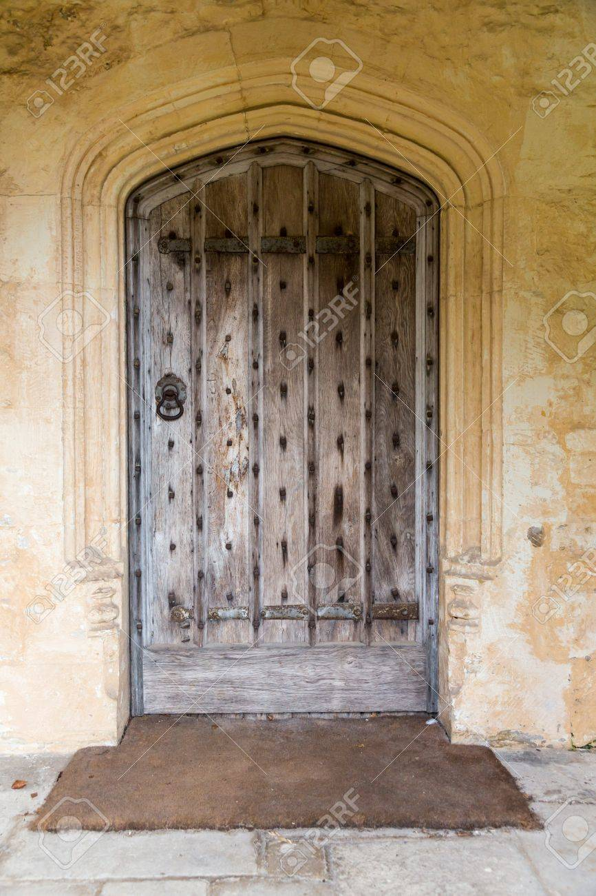 Old oak wood and stud door in cotswold stone entrance archway Stock Photo - 16449645 & Old Oak Wood And Stud Door In Cotswold Stone Entrance Archway Stock ...
