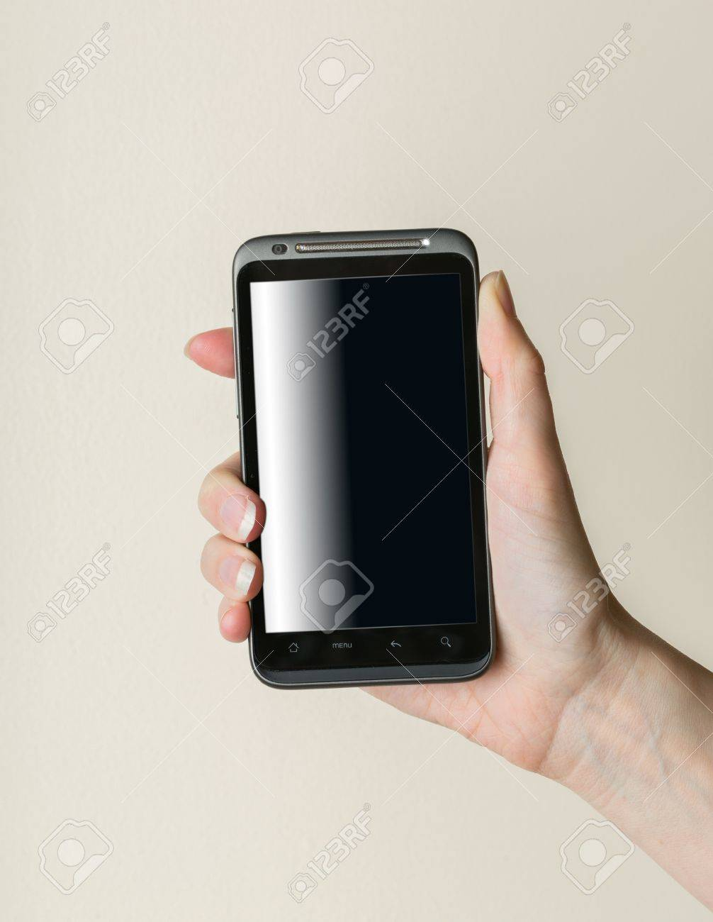 Female lady hand gripping black smartphone Stock Photo - 17170578