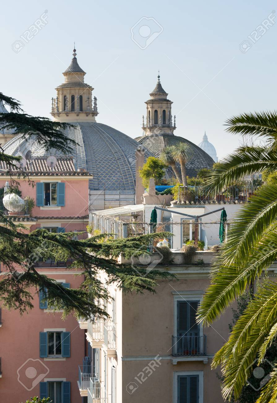 Twin roofs of churches on Piazza del Popolo above rooftops of Rome Stock Photo - 17933628