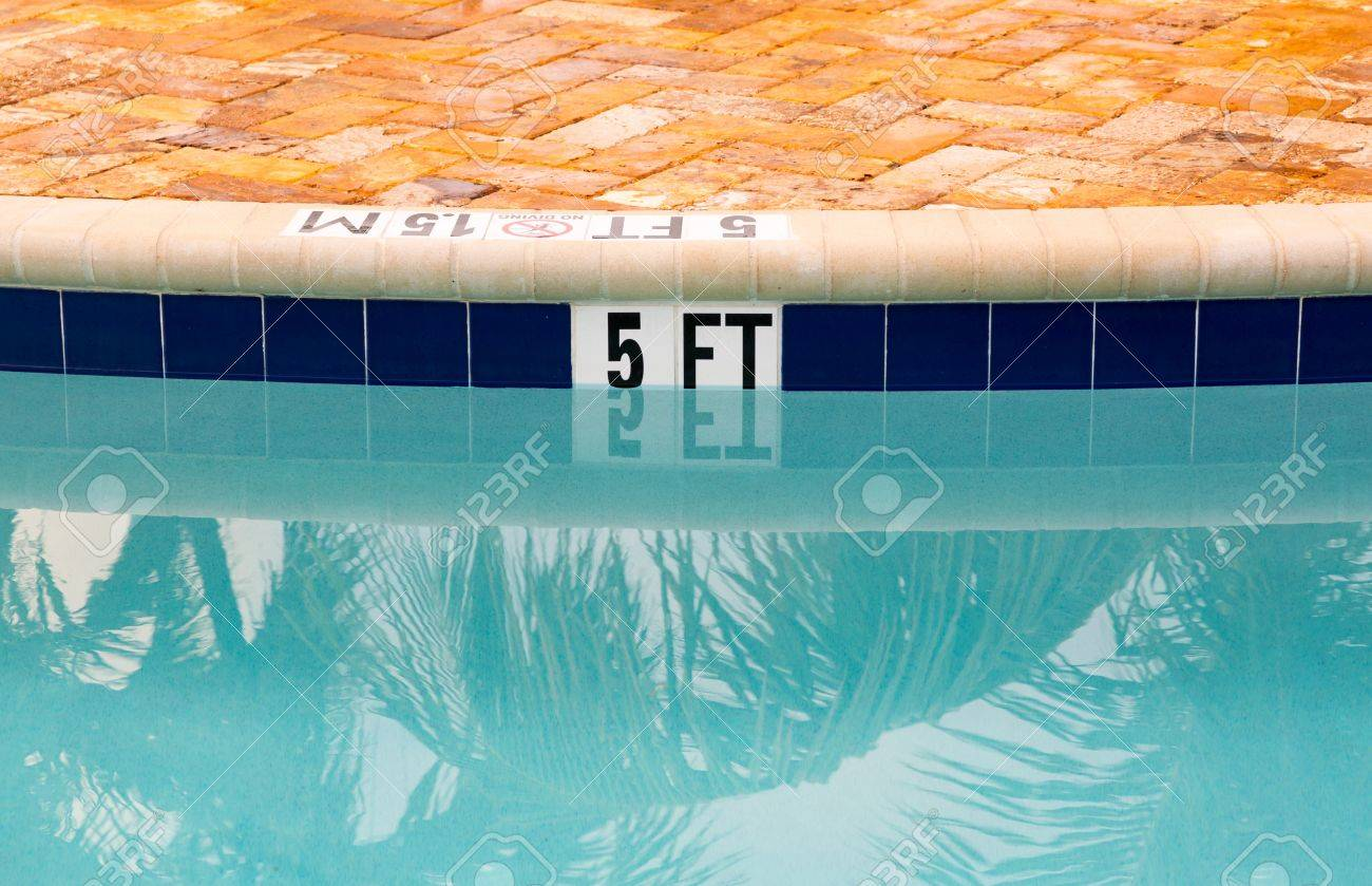 Sign Showing 5 Ft Depth On Edge Of Blue Swimming Pool With No ...
