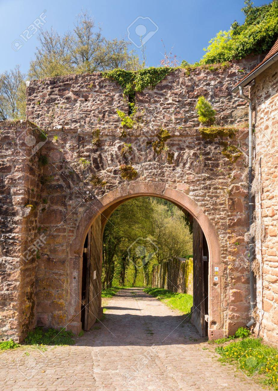 Oldcastle doors stone door of old castle stone arch in old castle walls with wooden doors and cobbled road in southern germany stock eventelaan Image collections