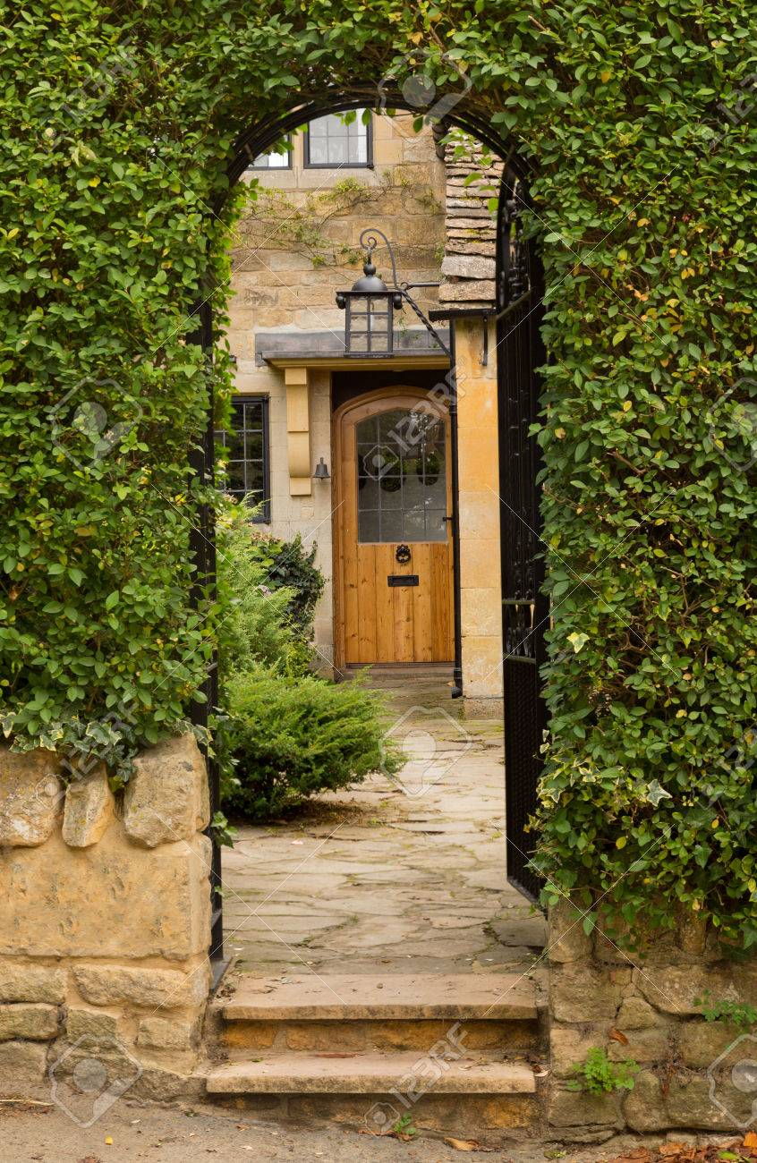 Front door of an old english cottage - Entrance To Front Door Of Cottage In Stanton In Cotswold Or Cotswolds District Of Southern England