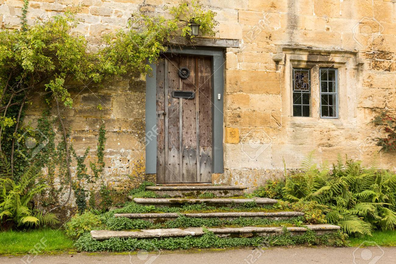 Front door of an old english cottage - Ancient Oak Front Door To Cottage In Stanton In Cotswold Or Cotswolds District Of Southern England