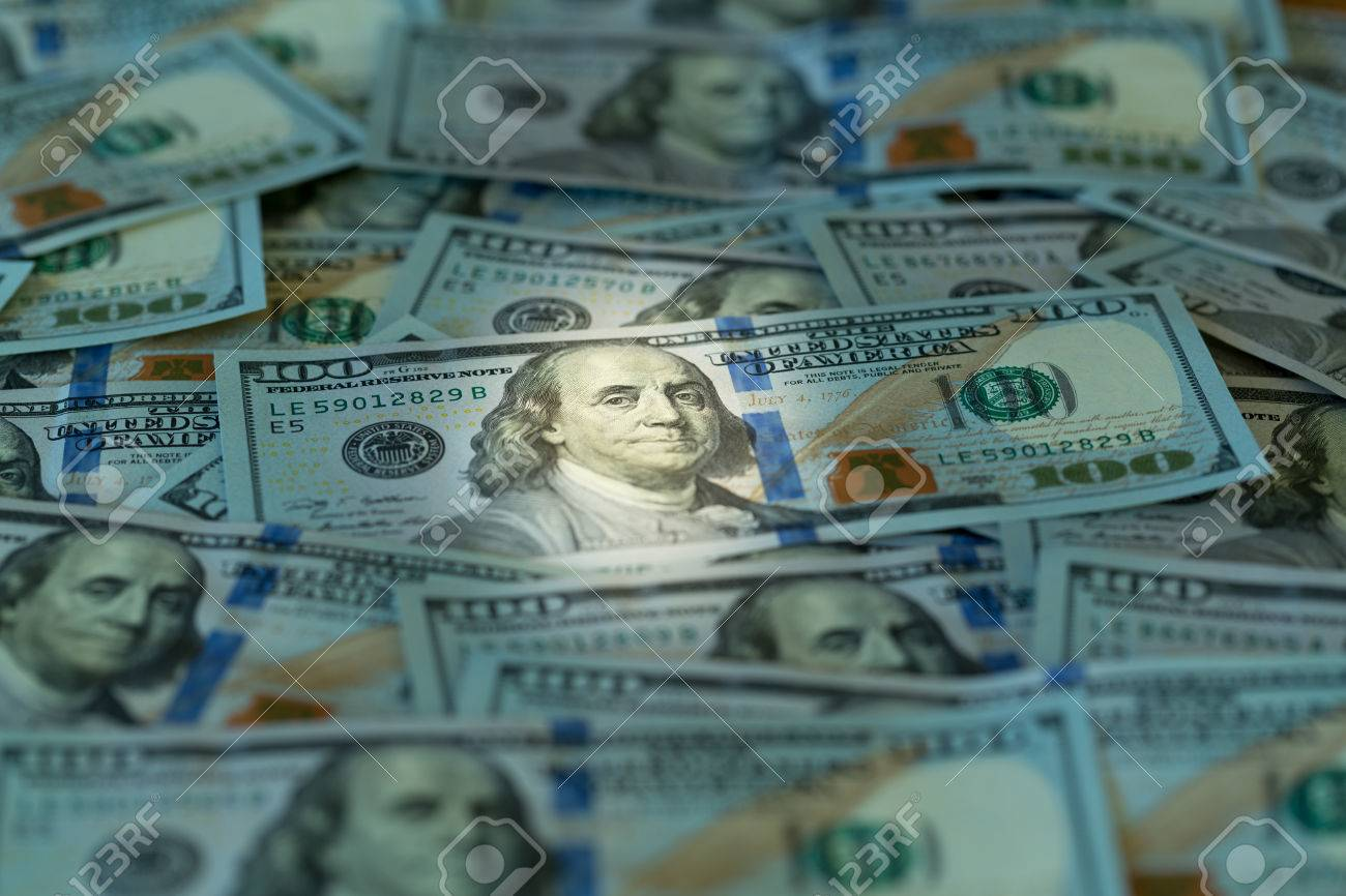 New design of US currency one hundred dollar bills laid out on