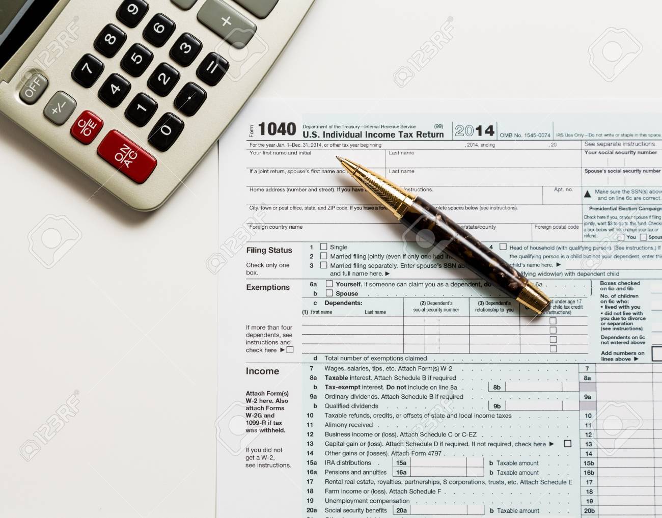 USA Tax Form 1040 For Year 2014 With A Pen And Calculator ...
