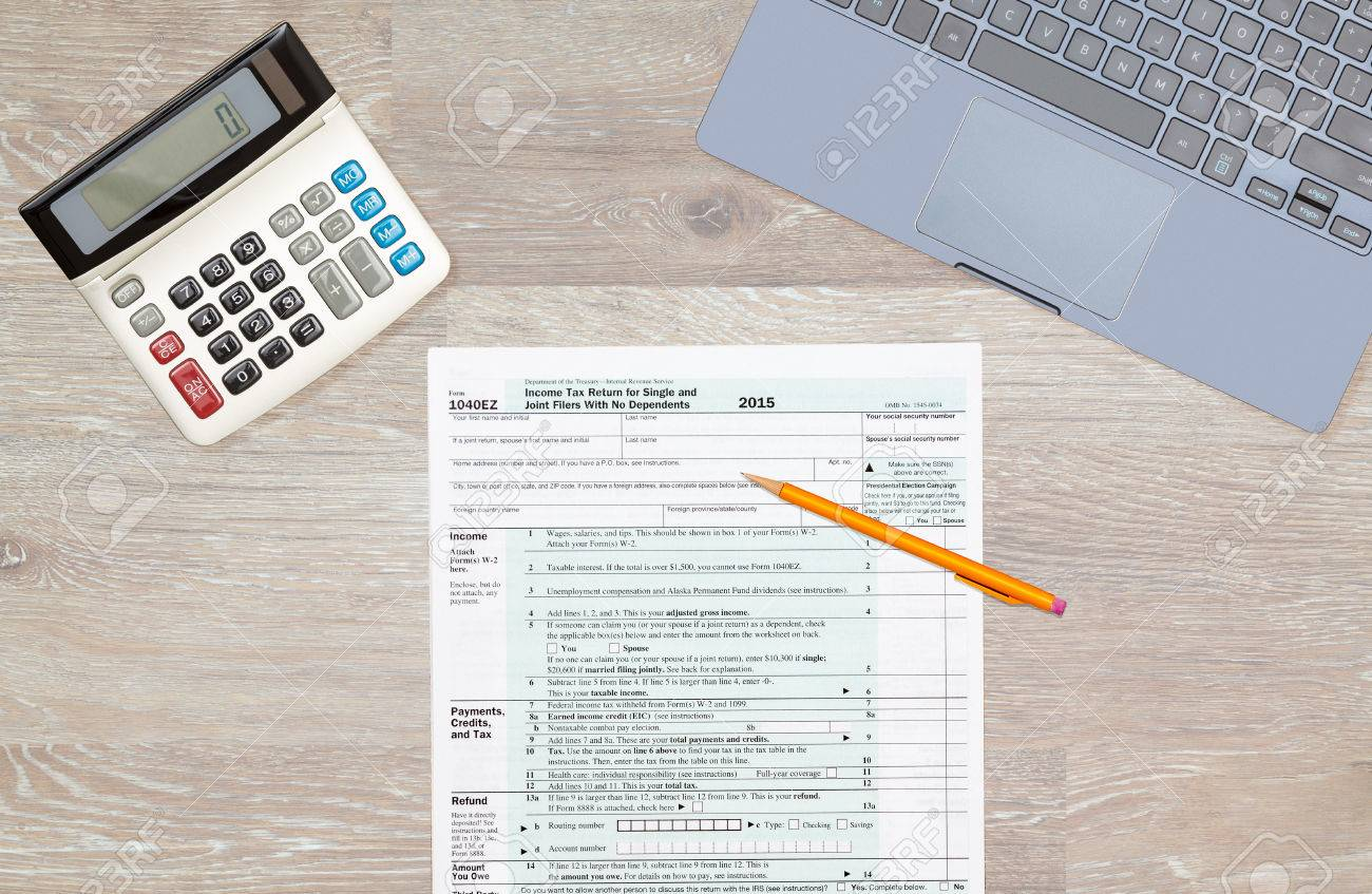 Usa Irs Tax Form 1040ez For Year 2015 With Pencils And Calculator