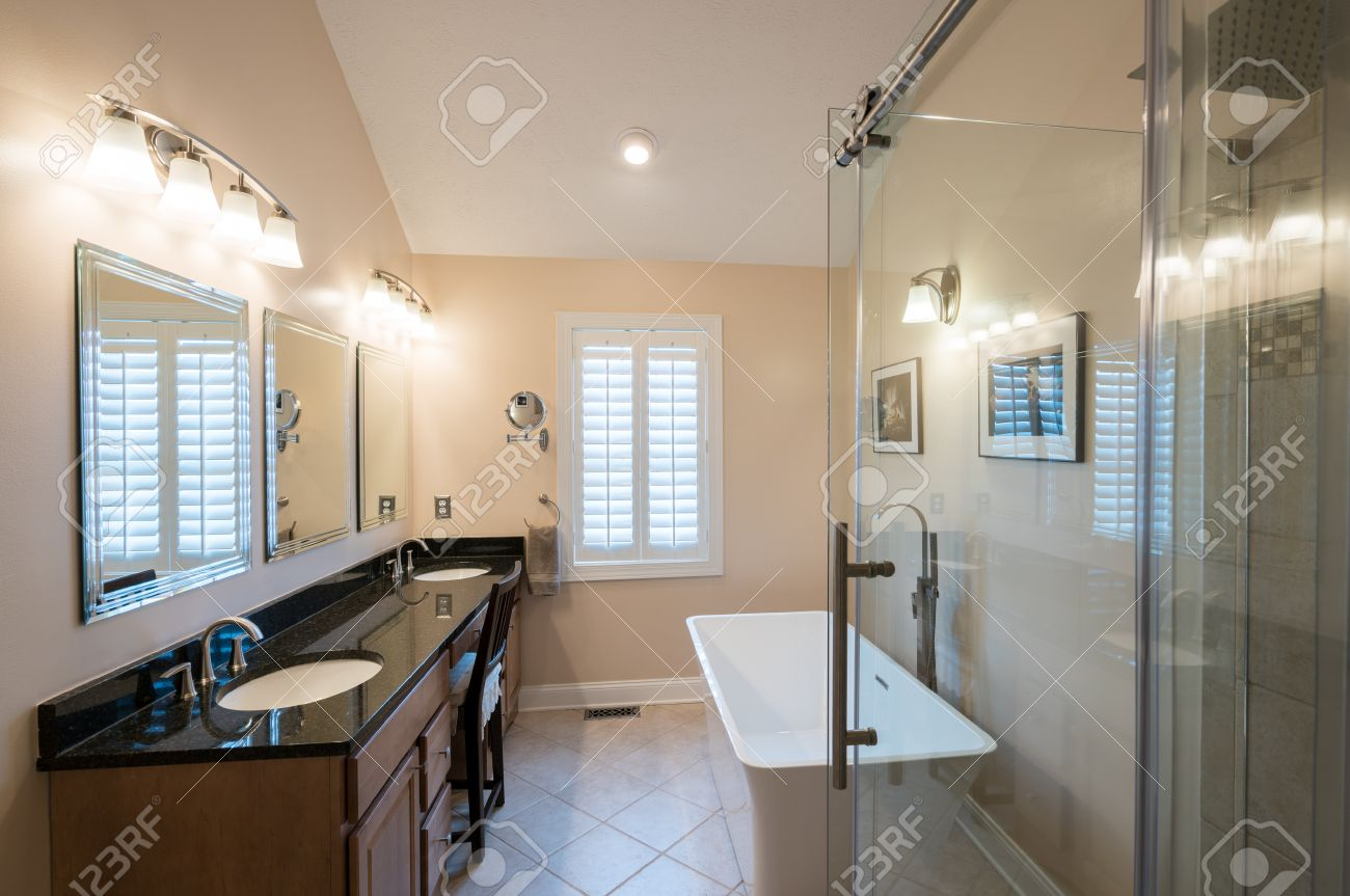 Interior Of Modern Bathroom With Standalone Tub, Walk In Double ...