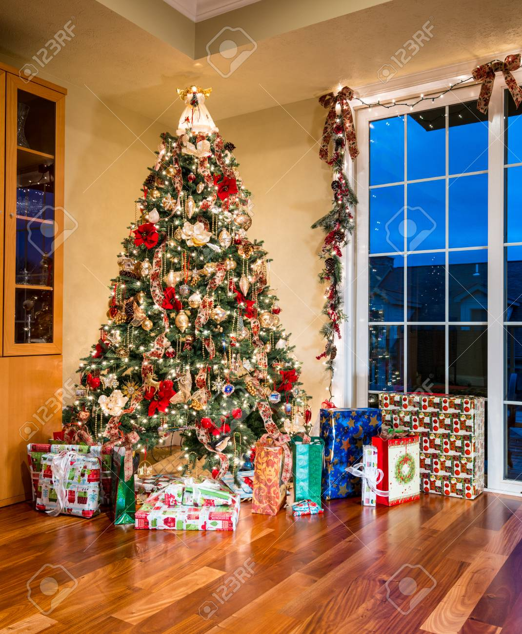 A Decorated Xmas Tree And Gifts Neatly Arranged Around The Base