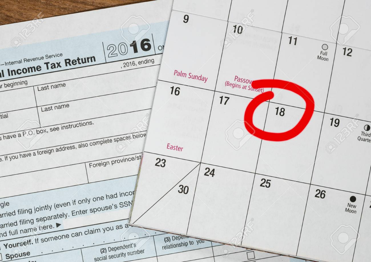 Calendar on top of form 1040 income tax form for 2016 showing