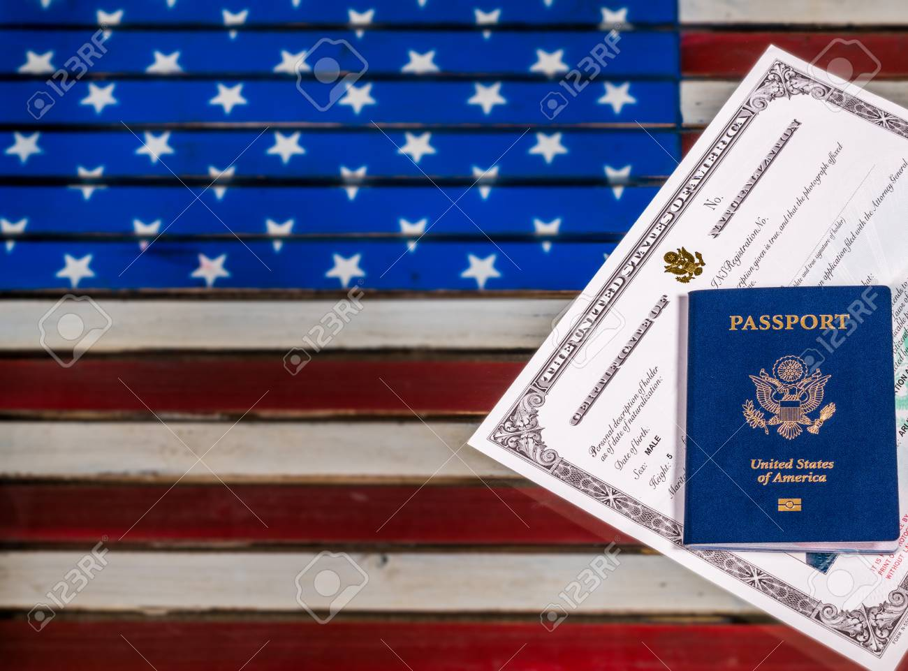 Usa passport and naturalization certificate of citizenship over usa passport and naturalization certificate of citizenship over background of a wooden us stars and stripes 1betcityfo Choice Image