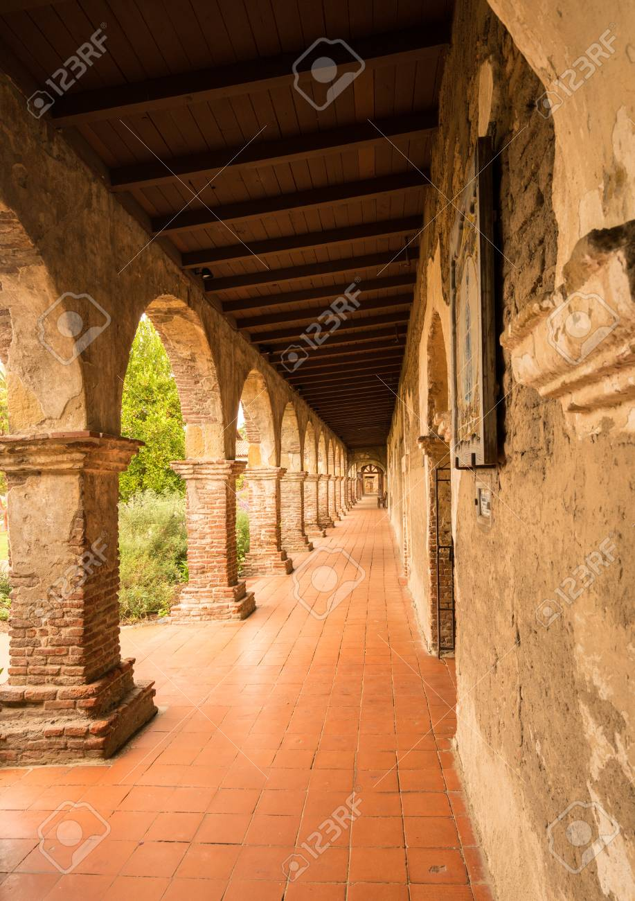 old brick arches around the cloisters of the mission at san juan